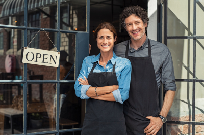 Two cheerful small business owners smiling