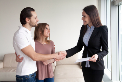 Couple shaking hands with a professional